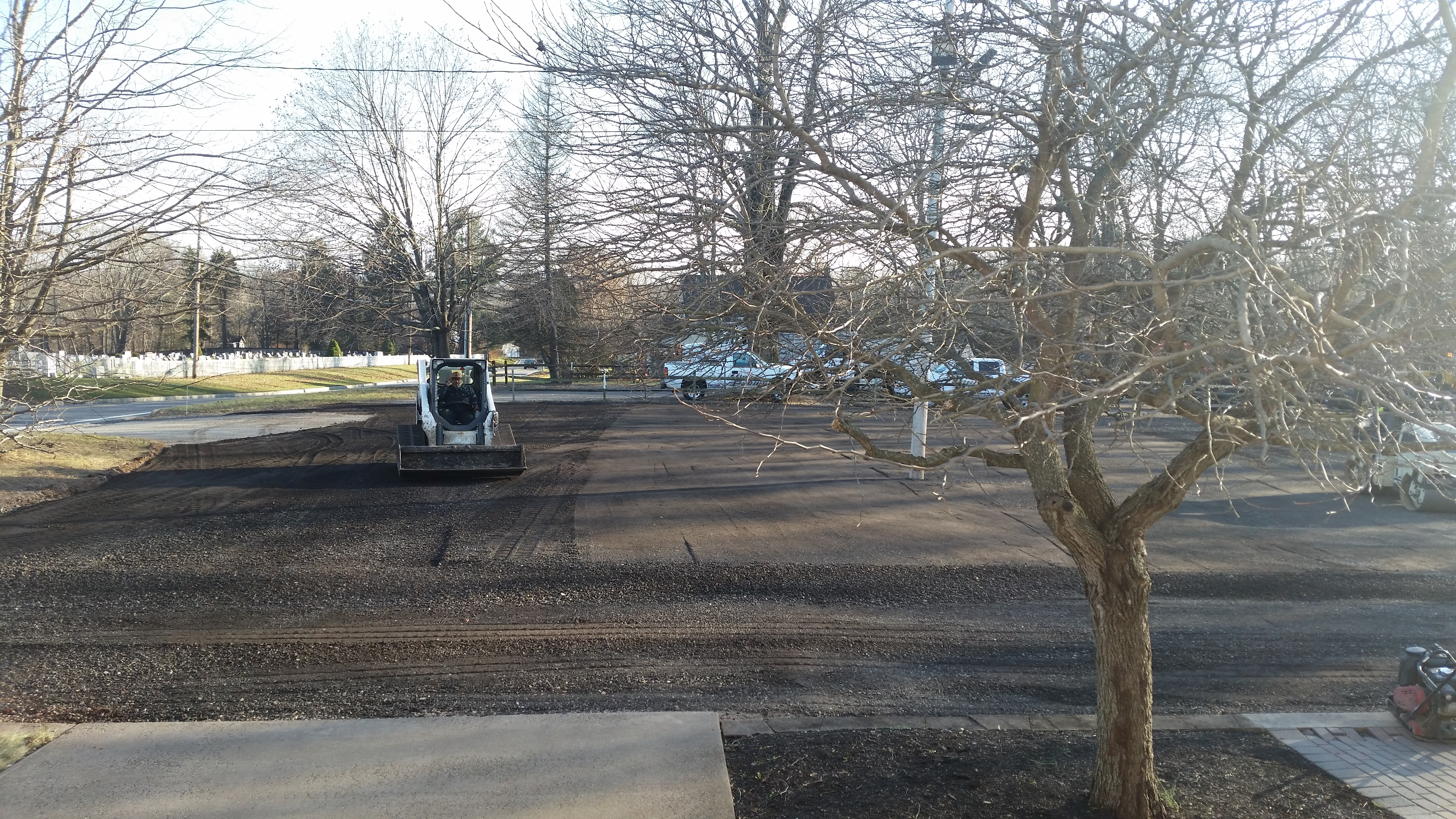 December 10_2018_Grading_and_compacting_the_parking_lot_.1